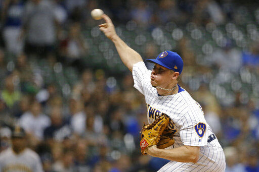 Anderson pitches 6 scoreless, Brewers stretch wild-card lead
