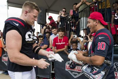J.J. Watt signs autographs, AP photo