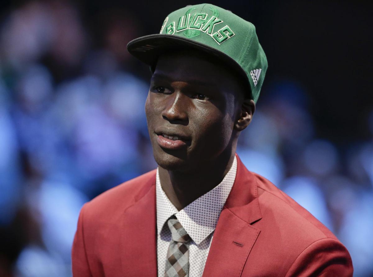 Thon Maker in Bucks cap after draft, AP photo