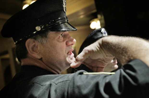 Police officer monitors Capitol singalong