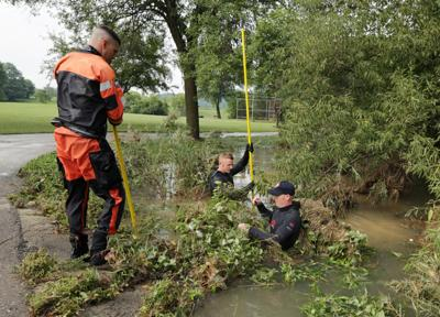 Passers-by hold flooding victim until water sweeps him away: 'He was