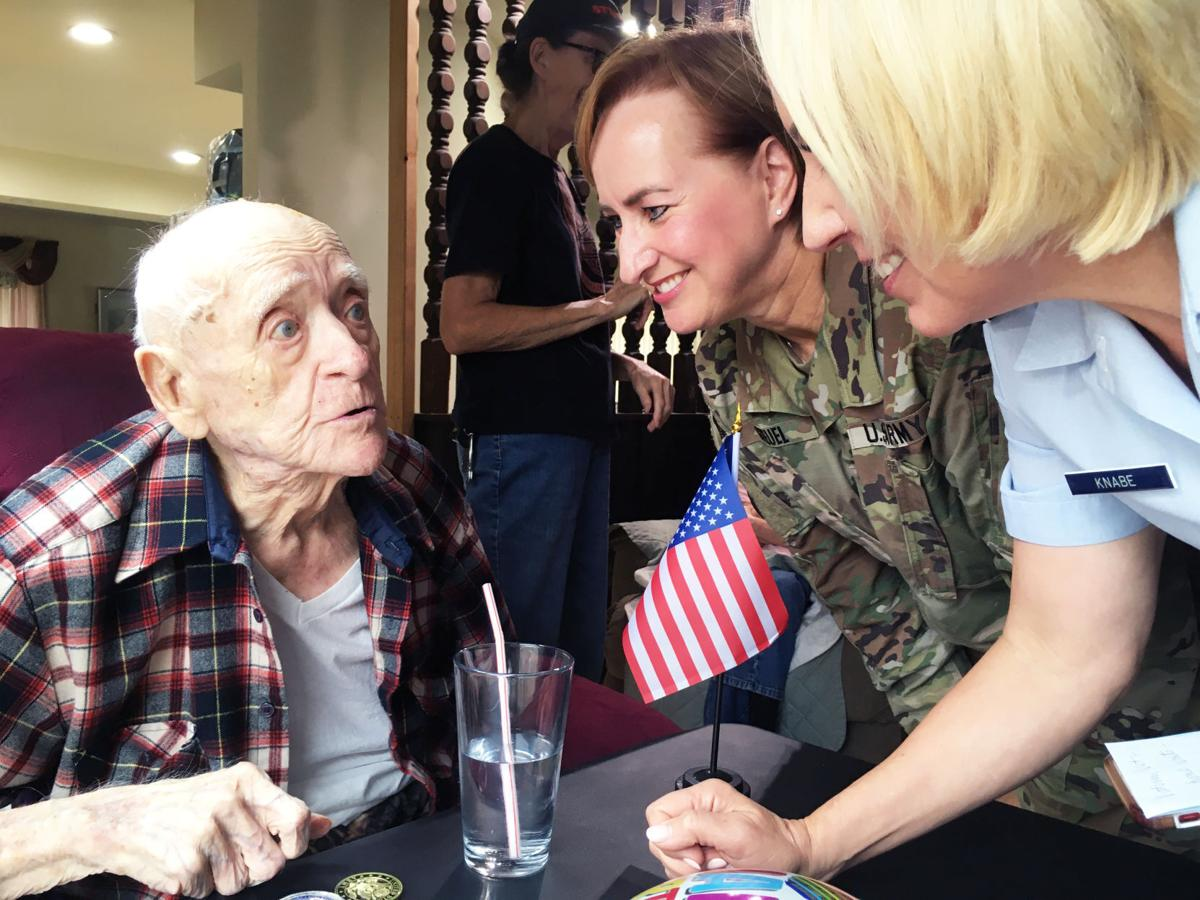 Roland 'Bud' Pater turns 106 with visitor from VA representatives