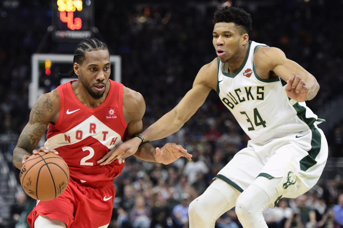 Kawhi Leonard guarded by Giannis, AP photo