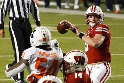 Graham Mertz passes against Illinois, AP generic file photo