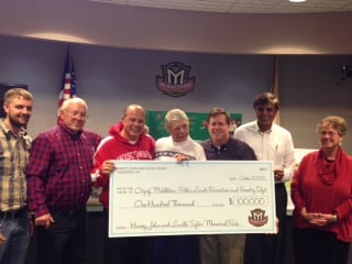 Lucille Taylor presents check to city