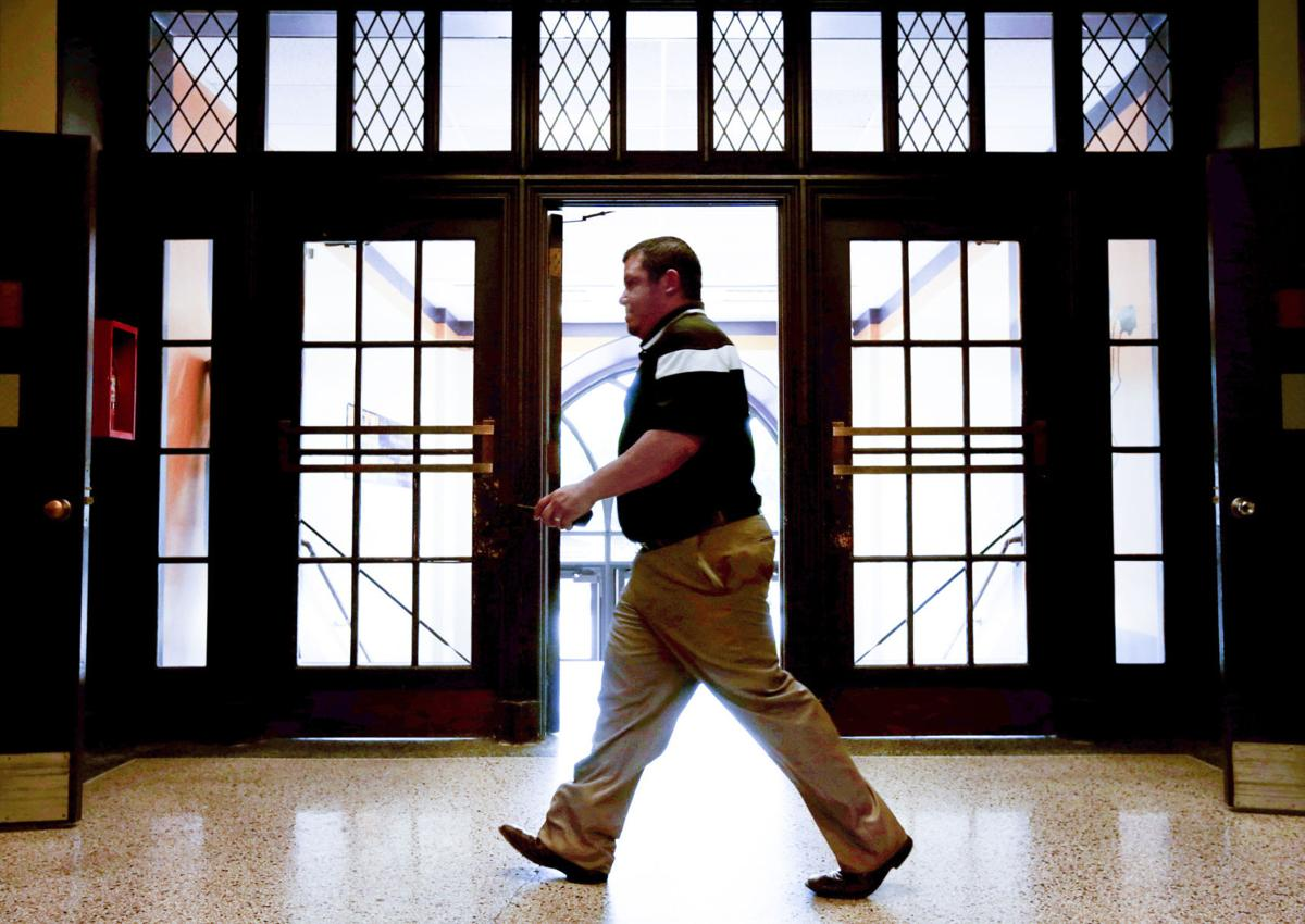 Michael Hernandez walking East hallways
