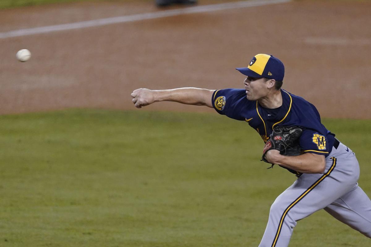 Justin Topa throws, AP photo