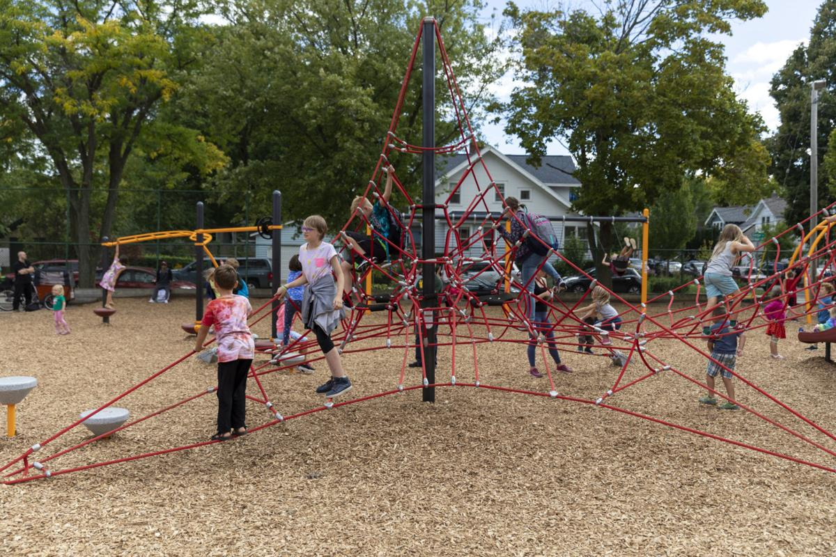 Children explore the new playground at Lowell Elementary School