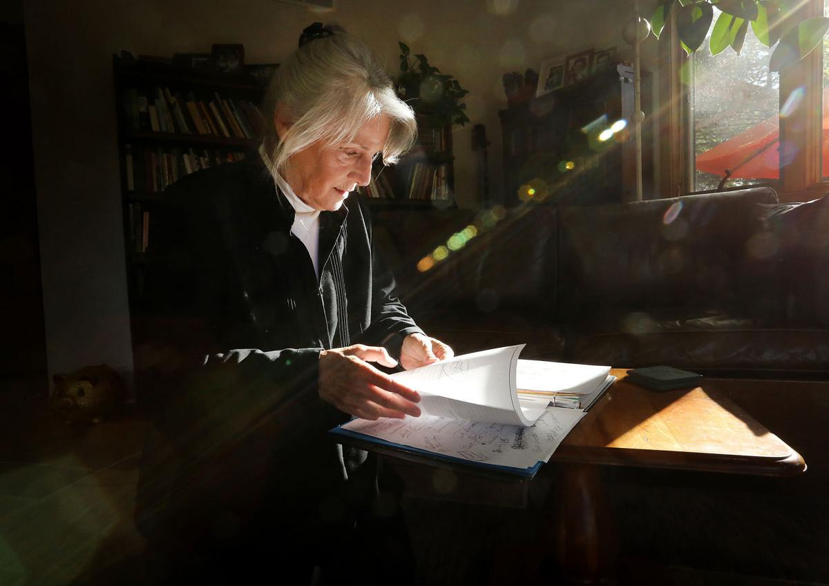 Valli Warren sifting through papers