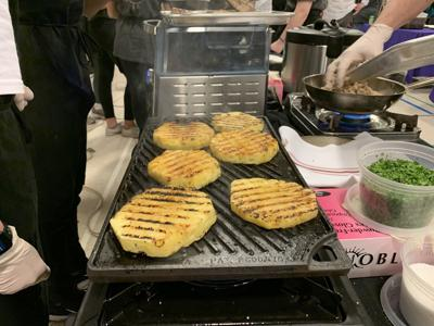 Students grill pineapple at Top Chef competition