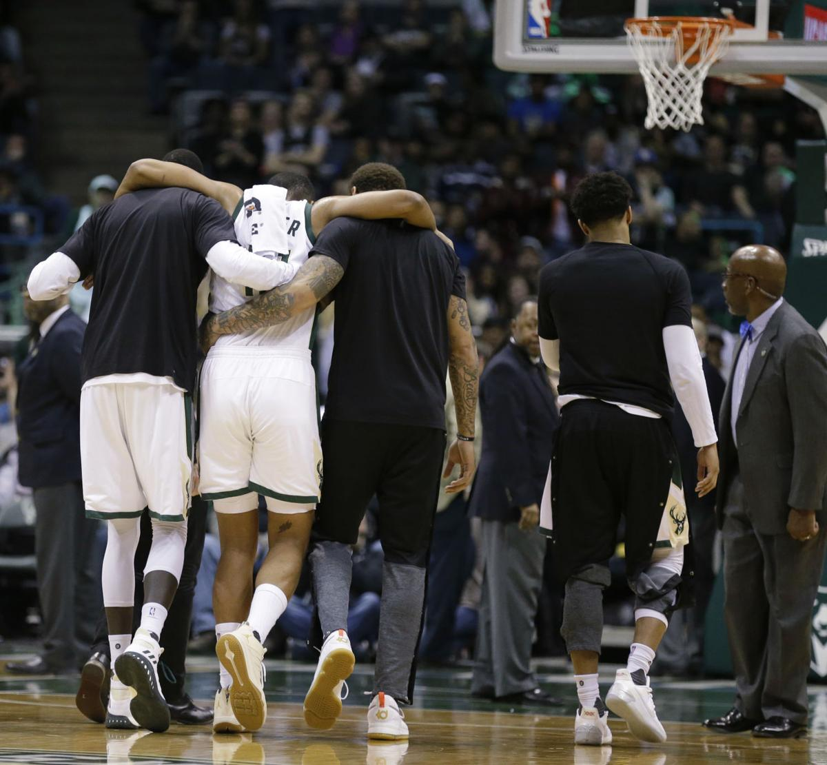 Jabari Parker carried off court knee injury, AP photo