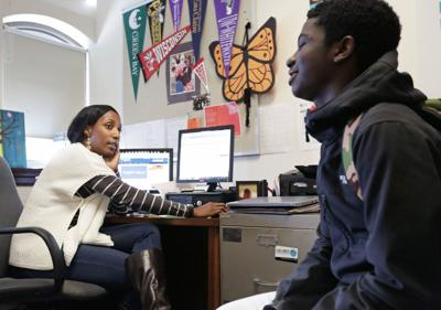 East High School counselor Robin Murphy meets with student