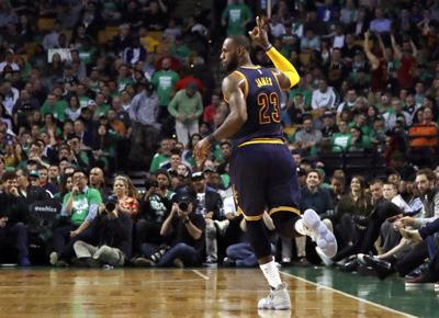 LeBrone James celebrates making NBA Finals, AP photo