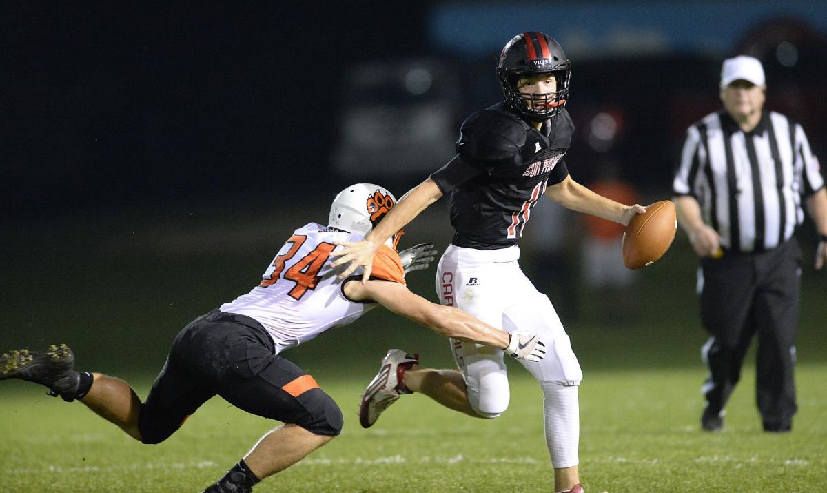 Prep football photo: Sun Prairie quarterback Brady Stevens on the run