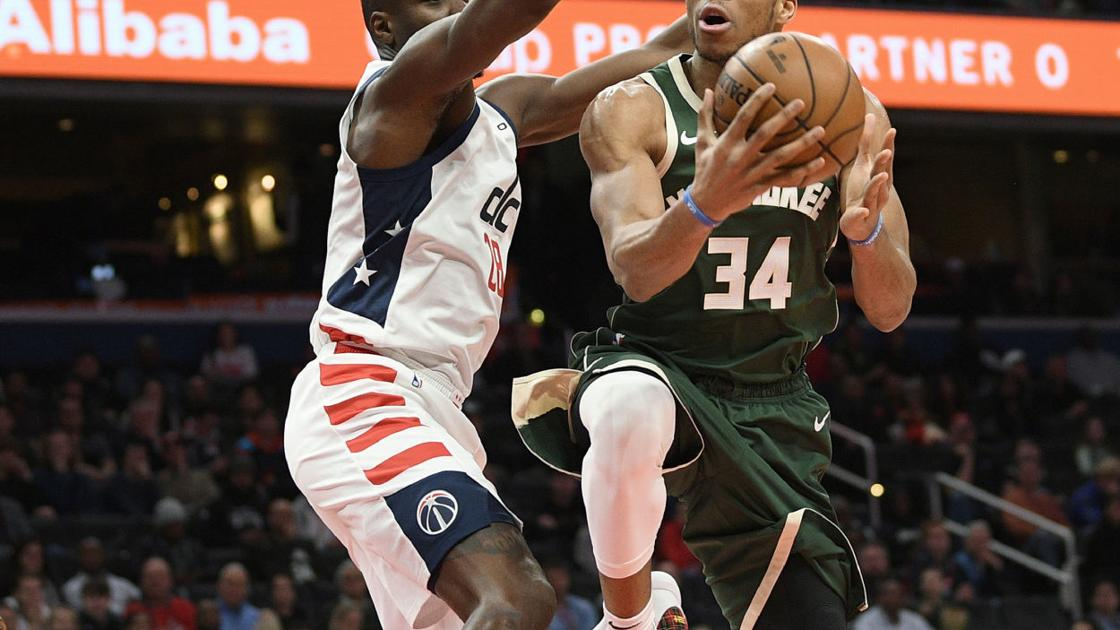 Khris Middleton pours in 40 points as Bucks tip Wizards in overtime