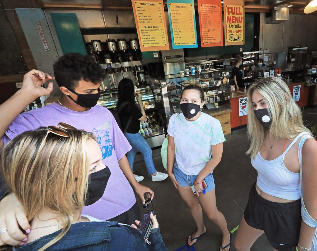 People wearing masks on State Street, State Journal photo