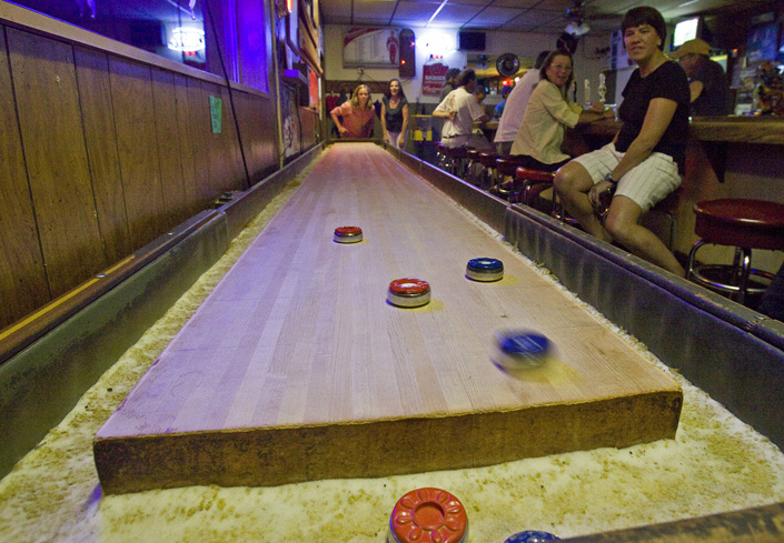 Players Enjoy A Game Of Shuffleboard At Woody And Anneu0027s Bar, Which Is A  Throwback In That It Still Runs A Weekly Shuffleboard League. The 22 Foot  Table Was ...