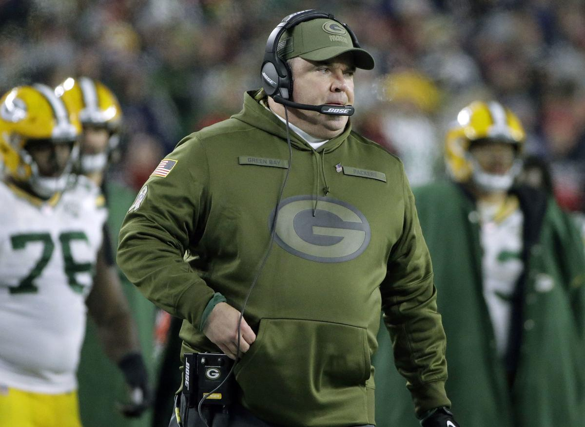 Mike McCarthy watches sidelines, AP photo