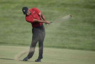 Tiger Woods hits, AP photo