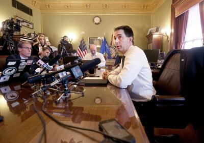 Scott Walker talks to reporters for first time after election loss