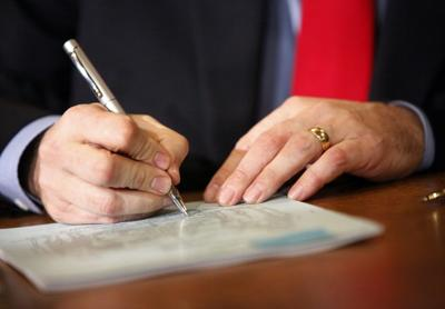 Walker signing bill into law file photo