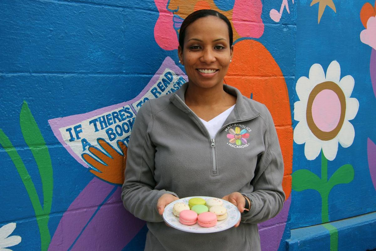 Crystal Jones in front of Madison Mural Alley with her macaroons  (1).JPG