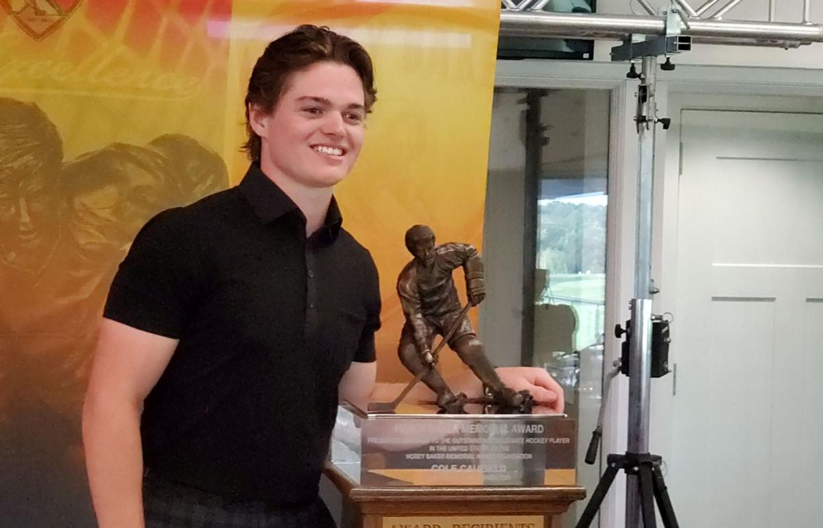 Cole Caufield with Hobey