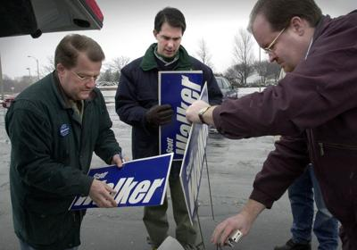 scott walker with tim russell and brian piedrick file photo 3/2/2002