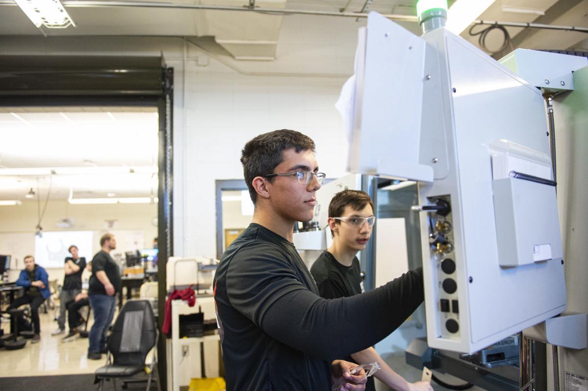 High schoolers making spaceship parts
