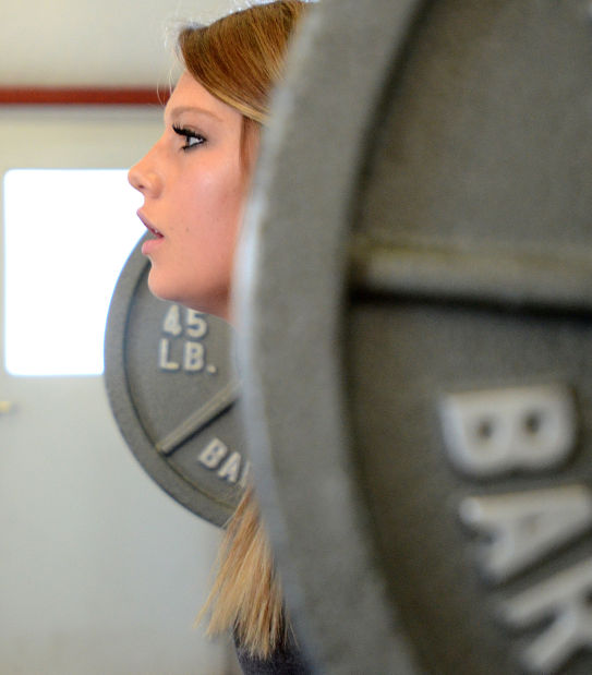 d38d2e73fad98 Local Teenage Girls Aim for Powerlifting Records