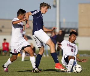 PHOTOS: Canyon Ridge and Twin Falls battle it out for a 2-2 tie