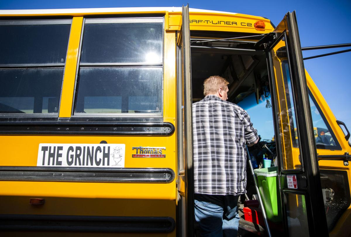 Bus drivers deliver food to students