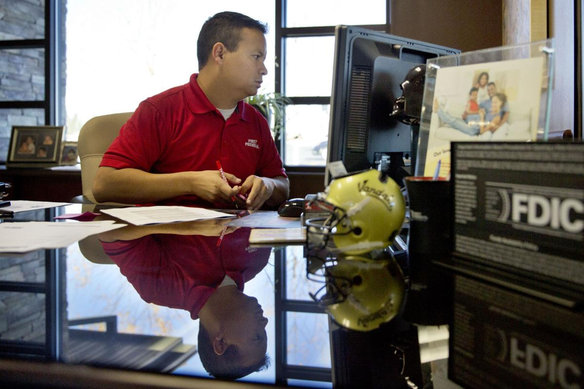Banks Work To Gain Immigrants' Trust