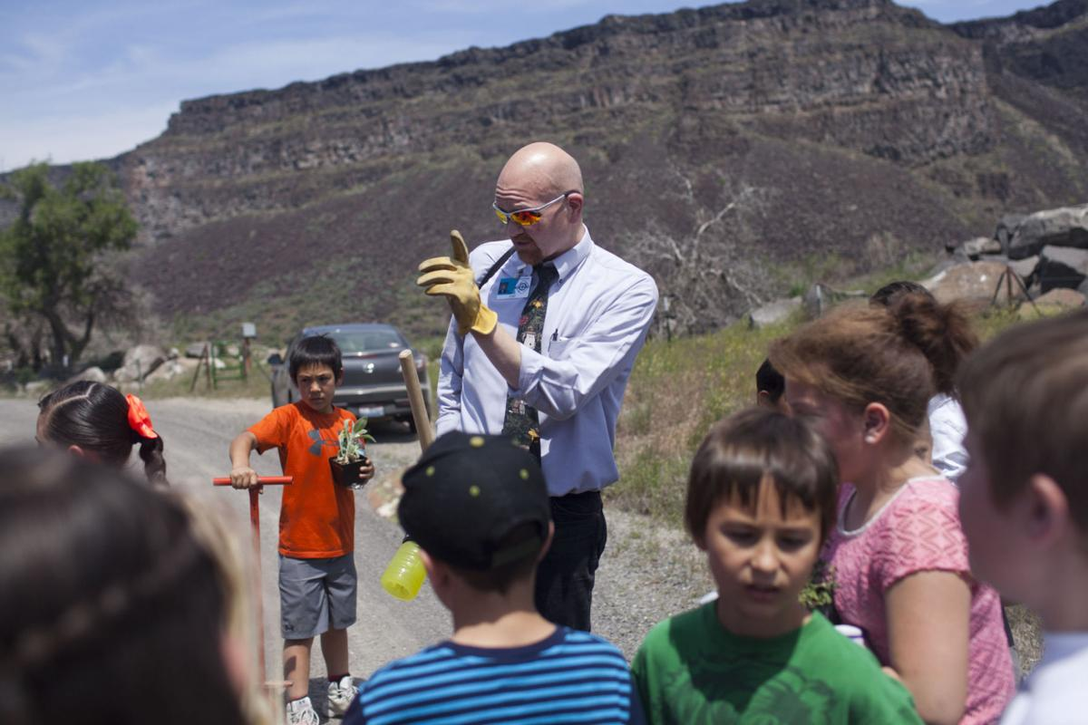 Oregon Trail Elementary Students Fighting Fires, One Plant
