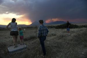 Colorado wildfire destroys 3 homes as flames menace US West