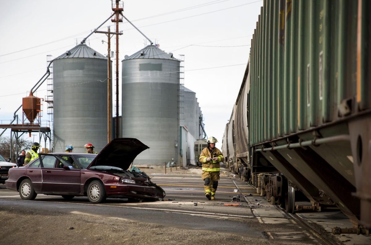 Car collides with train