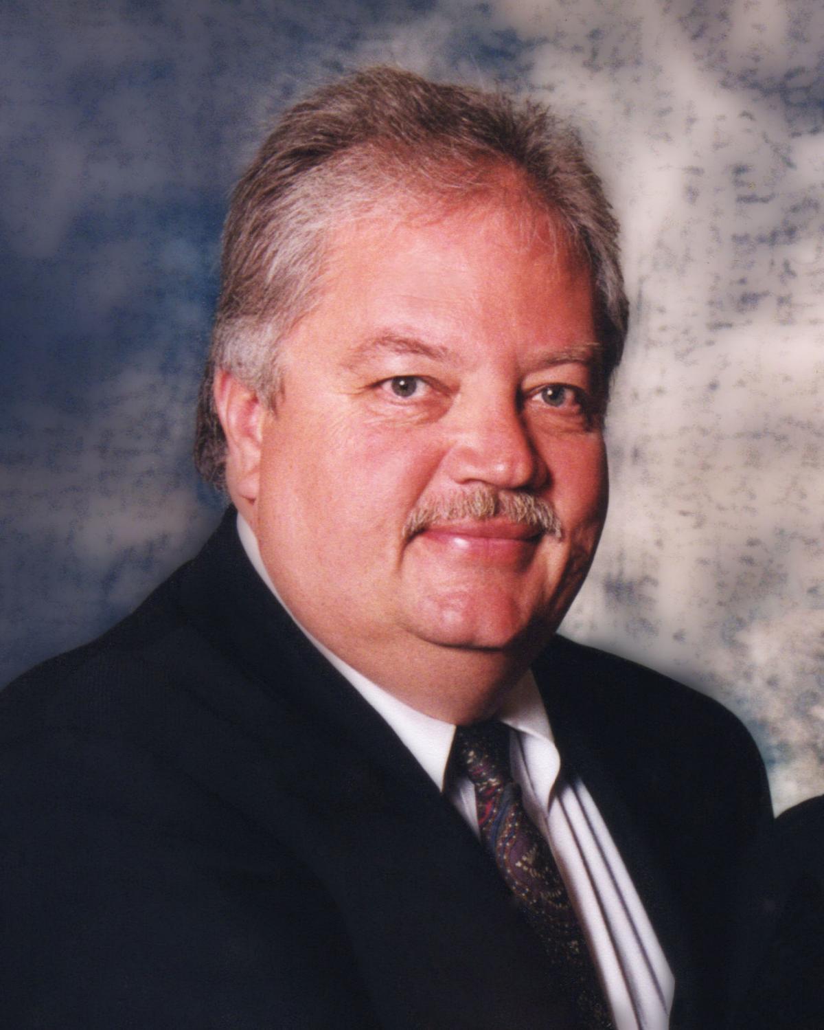 Obituary: Grant E Olenslager