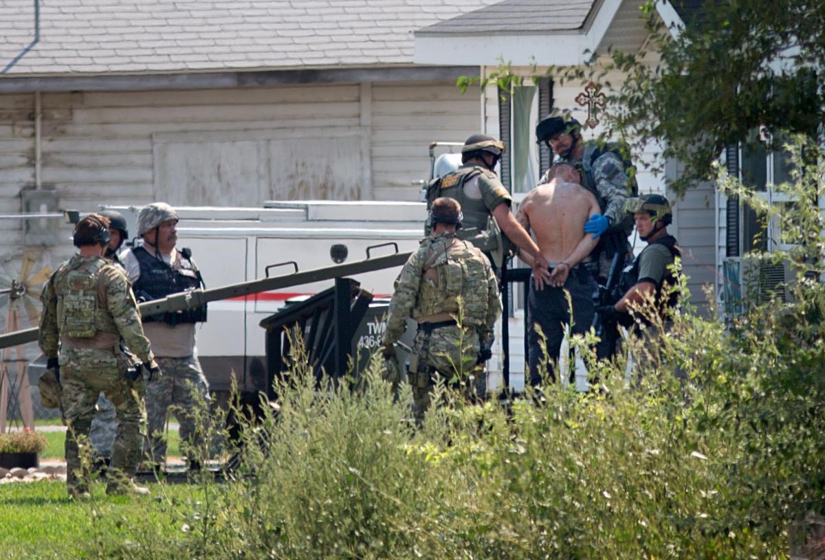 Man in standoff surrenders