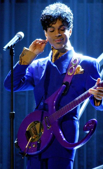 """Prince performs """"Purple Rain"""" as the opening act during the 46th Annual Grammy Awards show on Feb. 8, 2004 at the Staples Center in Los Angeles."""