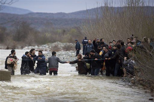 The Latest: Refugees say they were beaten in Macedonia