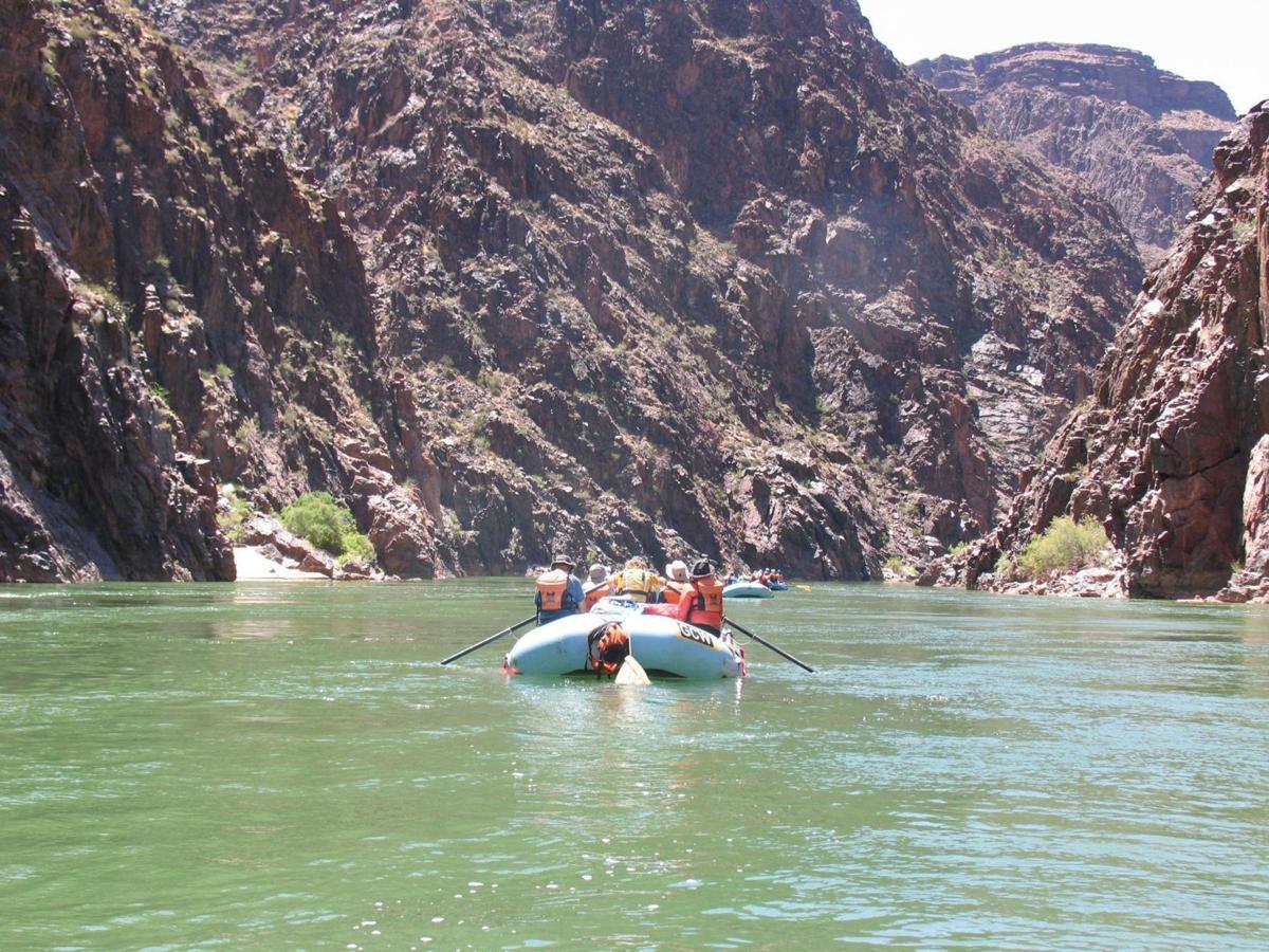 Rafting down the Colorado River through Grand Canyon National Park.