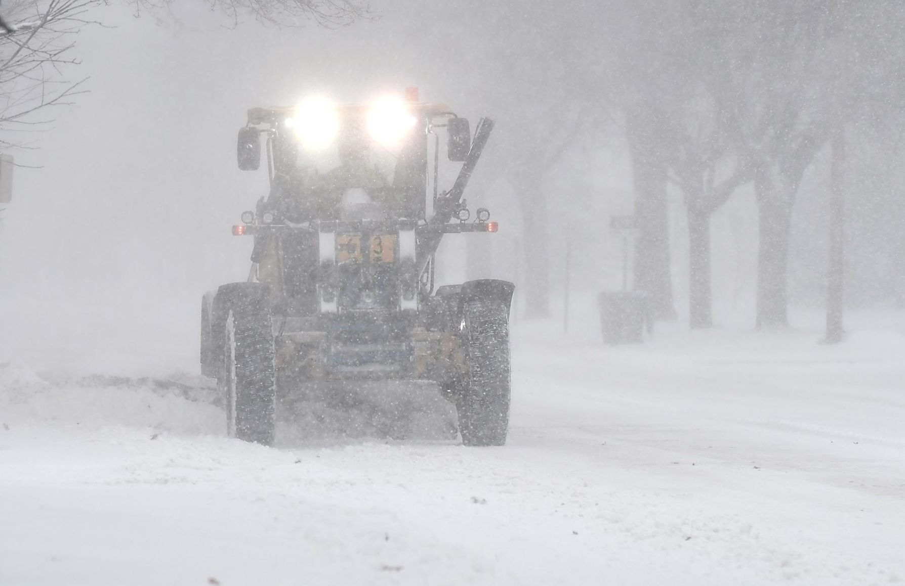 A City Of Mankato Snowplow Clears The Edge Of Broad Street During The  Snowstorm Monday. Photo By Pat Christman