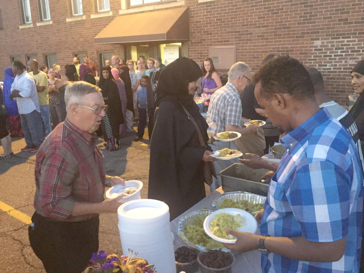 Area muslims invite community to break ramadan fast news mahamed noor right serves food to tom tonneson sunday as part of a ramadan gathering for the community sunday night muslims and non muslims waited until kristyandbryce Images