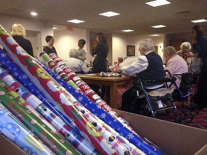 Primrose residents wrap gifts for the homeless