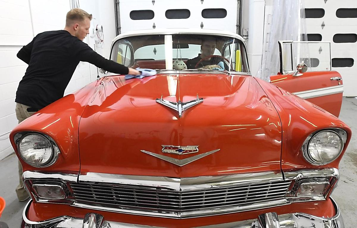 Vehicle hand washing and detailing shop opens in mankato news 360 car wash detailing employees adam macgregor left and nick rettmer put the finishing touches on a classic car during the shops grand opening solutioingenieria Images