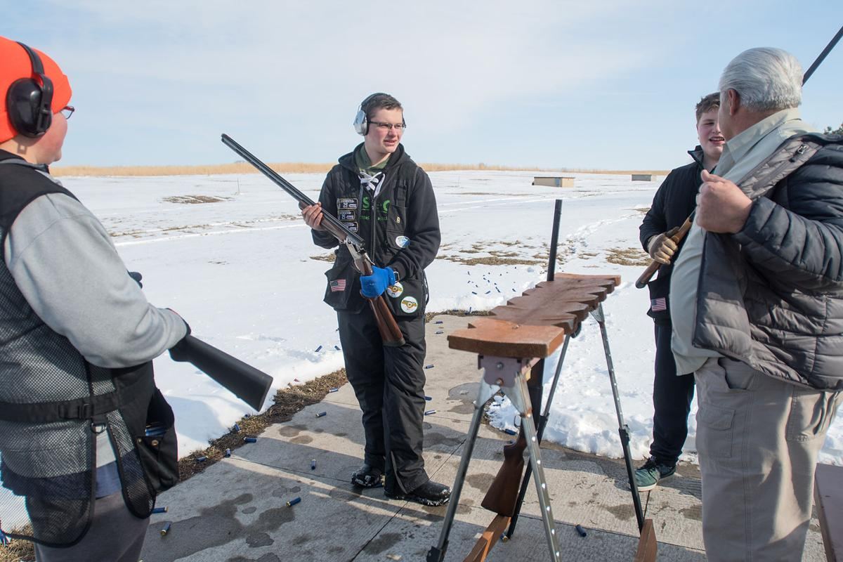 Jackson Gibbs Center Talks With Friends And A Coach Before Starting Round Of Trap Shooting At The Caribou Gun Club Said He Became Interested In