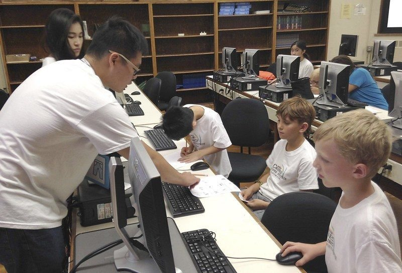 OPENING DOORS Businesses, individuals use local Chinese language classes