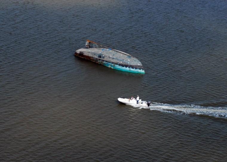 A capsized boat adrift in Galveston Bay