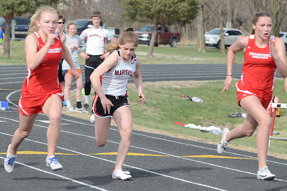 Frankfort's Maggie Armstrong, left, and Lydia Loiseau race against Mackenzy  Martin, Marysville, in the final heat of the 100-meter dash at last  Thursday's ...