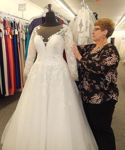 Diane Creek Owner Of S Dresses Etc Wymore Neb Adjusts A Wedding Gown On Mannequin She Calls The Her Is
